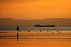 Sail Away (dotcomjohnny) Tags: sunset sea sky sun beach nature water beauty liverpool reflections sand natural sihouette sculptures mersey antonygormley sefton sigma1020mm dapa canon30d crosbybeach gapc dapagroup dotcomjohnny dapagroupmeritaward sigma180mmf35exdc dapagrouphalloffame dapagroupmeritaward5