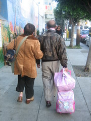 IMG_2267.JPG (tantek) Tags: sanfrancisco couple hellokitty luggage sidewalk mission oldercouple 21ststreet hellokittyluggage