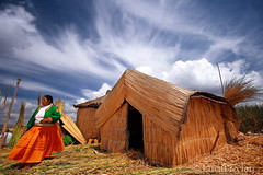 Once upon a time in South America (LucaPicciau) Tags: woman lake peru uros titicaca southamerica totora time folk quality floating per lp andes once titikaka isla americas puno flotantes