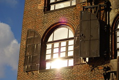 Old Warehouse Window Glare. (woodendesigner) Tags: new york old blue red sky sun white building brick window brooklyn clouds photo iron day glare waterfront market walk gorgeous historic warehouse shutters hook fairway