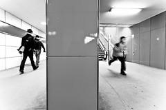 Different Directions (spreeliebe) Tags: building berlin canon deutschland person eos ubahnhof gang sw monochrom schwarzweiss rennen junge metrostation schoeneberg mensch berlinberlin bayerischerplatz kleinbild digitalfotografie verkehrsgebaeude 5dii canoneos5dii fotomedium