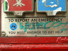 You Must Answer to Get Help (Rachel Pincus) Tags: blue red newyork fire graffiti weird sticker funny police highlights gothamist incongruous smileyface