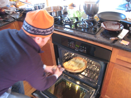 Michael came over and made baked pancakes that were spectacular - Pulling the pancake from the oven