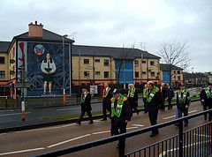 AOH Parading through the Bogside on St. Patricks Day 2008 (sean and nina) Tags: city ireland people irish church saint st corner march scotland ancient catholic order candid centre president banner free murals scottish police flags eire sash parade na diamond motorbike bands bogside procession patricks piper bagpipes mass banners republican nationalist ord pats derry arsa ulster aoh padraig papal hibs hibernians eireann heireann doire paraid bannerette collarettes