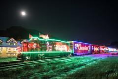 The Holiday Train (Kristin Repsher) Tags: alberta canada canadianpacific canadianrockies canmore christmas christmaslights d750 fullmoon holidaytrain kananaskis longexposure nikon rockies rockymountains train