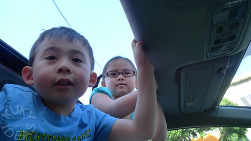 Isabelle hanging out in the car with her cousin Ebow