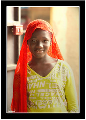 Le voile rouge (Laurent.Rappa) Tags: voyage africa unicef travel portrait people face children child retrato laurentr enfant ritratti ritratto regard ctedivoire peuple afrique ivorycoast ivorycost megashot superhearts photofaceoffwinner colourartaward artlegacy laurentrappa