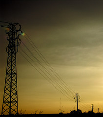 (maxlaurenzi) Tags: autumn sunset sky orange strange electric clouds darkness perspective pylon mantua regularity