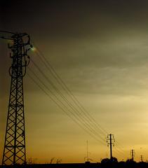 (maxlaurenzi) Tags: autumn sunset sky orange strange electric clouds darkness perspective pylon mantua regularity