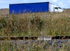 staying on track (bluerosellared) Tags: blue sky country numbers grasses gravel bluetruck railline trackline