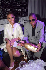 jay-z holding a bottle of ace of spade with beyonce