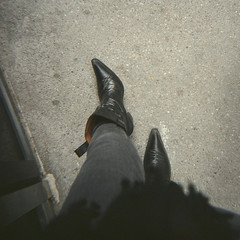 Bored (Elinor Zach) Tags: film me mediumformat holga boots pavement jeans cowboyboots