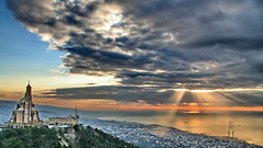 Surreal Sunset (hazy jenius) Tags: city sunset sea urban panorama lebanon church nature catchycolors landscape colorful day view cloudy middleeast vista liban libnan harissa jounieh medditerranean