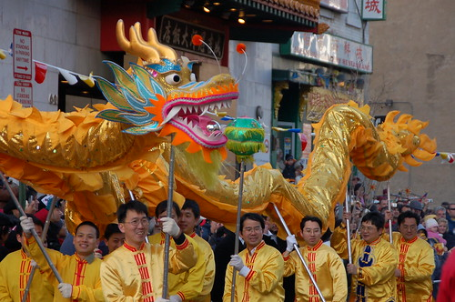 Golden Dragon Dances Around the Firecrackers
