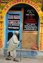 Photo Making (greenwood100) Tags: poverty street door blue india yellow shop contrast speed hair bag walking hotel glasses high travels shoes arm cd taxi air internet ticket front burning elderly age service stick remote mp welcome cloth tours internetcafe std connection cybercafe reservation welcomes booking orcha madhyapradesh highspeedinternet orchha cdburning flickrdiamond slumdog