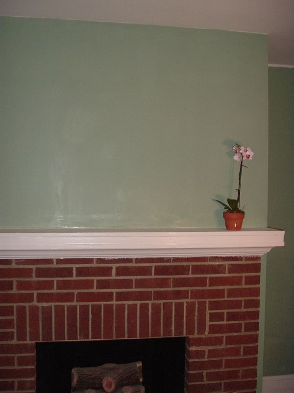 Fireplace with freshly painted wall
