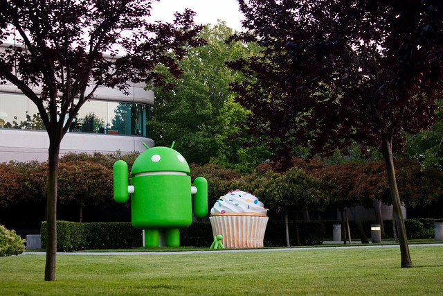 Giant Google Android statue with puppy and cupcake