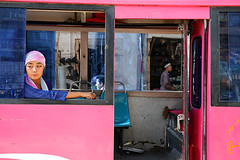 Ticket inspector's boring day (Pawel Boguslawski) Tags: china pink people bus canon asia kashgar kashi 400d feltlifepod mainlanderchina