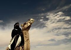 Tuareg riding a camel, Libya (Eric Lafforgue) Tags: africa sky sahara northafrica culture tribal hasselblad camel ciel tribes nomad tradition tribe ethnic libya tribo touareg tuareg ethnology tribu nomadic dromadaire chameau libia libye libyen ghadafi fezzan h3d  lbia 13837 lafforgue italiancolony ethnie jamahiriya libi ericlafforgue nomadiclife libiya  ribia liviya khadafi ghadamis libija  ghadmis       lbija  lby  libja lbya liiba livi