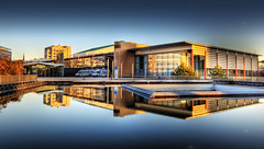 Kongresshalle (Wolfgang Staudt) Tags: bridge blue autumn trees windows sunset red sky sun colour reflection building art fall water colors beautiful leaves sunshine clouds germany office amazing nice pond nikon europa nikond70 decay framed tripod saturday sigma frame stunning brcke reflexions bro spiegelung hdr offices orton 2007 nicecolors saar saarland saarbrcken flintstone saarlorlux ziegel kongresshalle sarre congresshall refektion amazingtalent 6111  wolfgangstaudt theunforgettablepictures colourartaward sarrebrck goldstaraward