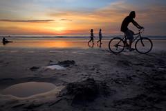 Kuta beach - Bali (Aur from Paris) Tags: bali indonesia indonesie asia landscape seascape asie water sea sunset sun scenic sand bicycle bike beach kuta legian flickrelite shore surf light aur canoneos5d travel digitalblending