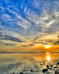 Sunset (espion) Tags: travel sunset sea sky painterly reflection river rocks ships dramatic surreal flats shore beacon hdr cloudscape wispy 500v cirrus feathery altocumulus colorphotoaward chalcidic hdrselect
