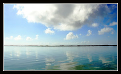 Silencing My Sorrow (redmann) Tags: ocean sea cloud reflection water clouds canon reflections island key cuba sigma caribbean cay cayococo canon400d aplusphoto sigma18200dcos ciegodeavilaprovince