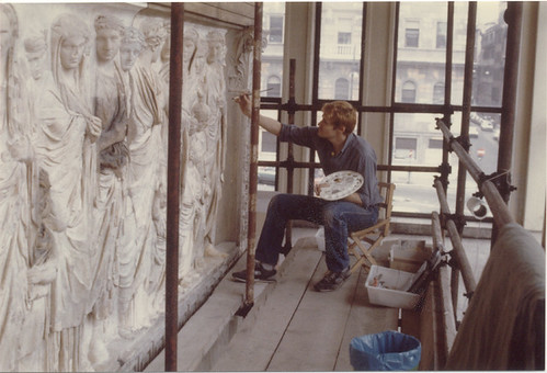 modern sculptor working on marble relief