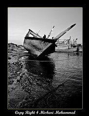 Nostalgia Captain .. (Meshari Al Khuder [ Vision ]) Tags: old me lens boats boat angle wide grandfather master captain kuwait nikkor past ahmed ultra soe 1224mm breathtaking doha q8 blueribbonwinner golddragon mishari cameradeourobrasil diamondclassphotographer flckrdiamond ysplix betterthangood bwartaward alkhuder