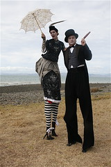 """We do like to be beside the seaside"" (siberfi) Tags: newzealand party portrait hat festival couple top stripes victorian feather couples surreal cigar parasol tophat nz victoriana northisland wearableart 2008 stilts p1 stiltwalker nz2 alltheworldsastage splore splore08"