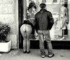 window shopping (loungerie) Tags: street bw window look shop couple watch bodylanguage stranger bn frombehind shopwindow vetrina livorno windowshopping coppia streetshot guardare leghorn 90gradi