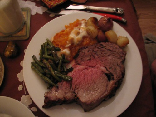 standing rib roast, whipped sweet potatoes, green beans and boiler onions