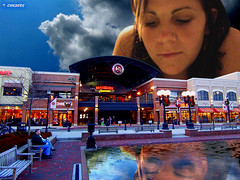 A Giant To Watch Over You (rcvernors) Tags: people woman cinema reflection brick water pool strange photoshop altered bench giant geotagged becca streetlamp huntington digitalart surreal odd wv westvirginia computerart chopped ripples allrightsreserved pullmansquare photoshopart huntingtonwv rcvernors altereduniverse