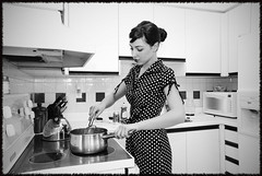 House Wife (monsters.monsters) Tags: bw woman cooking kitchen fridge stainlesssteel dress save3 content save7 save8 delete save save2 explore pot kettle polkadots save9 save4 stove save5 save10 microwave save6 housewife savedbythedeltemeuncensoredgroup housedress