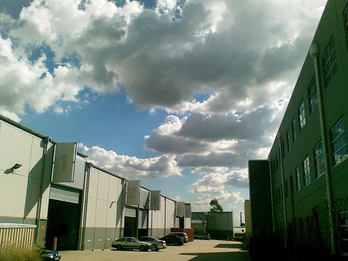 Clouds above warehouse