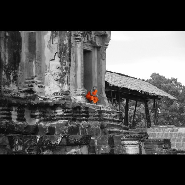 Monk resting at Angkor Wat