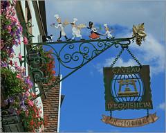 Bravo Caveau (canong2fan) Tags: sign geotagged restaurant village bluesky windowbox eguisheim flowerscolors canonefs1785mmf456isusm canon400d leuropepittoresque