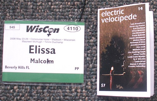 WisCon Badge and folded EV Flyer