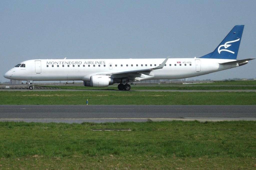 4O-AOA, Embraer 195LR, c/n 180, Montenegro Airlines, CDG/LFPG, 04/2011