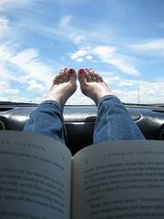 harry potter and i on the road (::fotorosso::) Tags: road trip blue sky santafe feet me car clouds self harrypotter books roadtrip jeans barefeet dashboard