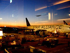 Narita Tarmac (St Stev) Tags: blue sunset sky orange sun blur reflection japan set night port plane way japanese star tokyo airport wings twilight asia air flight wing run aeroplane luggage international  nippon metropolis  fin baggage runway nihon narita alliance