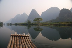 View from the bamboo-boat (magical-world) Tags: china travel original sunset mountain river landscape mirror boat asia bamboo creativecommons reflexion 2007 worldtrip magicalworld yuangshuo lpfloating