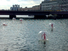 Ball People of Fort Point (bettlebrox) Tags: red people water station boston ball river point nokia fort south postoffice sphere mick visitors visitor channel southstation fortpointchannel bostonist borgcube n73 ballpeople mickt clearsphere redballpeople