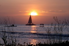 Sunset Aruba Style (*Michelle*(meechelle)) Tags: sunset sailboat boat searchthebest aruba sail ih smrgsbord cubism blueribbonwinner golddragon mywinners anawesomeshot aplusphoto flickrplatinum superbmasterpiece diamondclassphotographer flickrdiamond flickrelite heartawards theunforgettablepictures extraordinarycompositions brillianteyejewels platinumheartaward platinumhearts diviphoenix theperfectphotographer goldstaraward dragongold naturallyartificial guasdivinas oldplatinumhearts oldheartawards