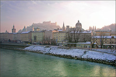 A cold misty winter afternoon in Salzburg (rotraud_71) Tags: houses winter sky people sun mist salzburg cars water austria evening searchthebest towers fortress thecontinuum outstandingshots riversalzach golddragon abigfave platinumphoto colorphotoaward superbmasterpiece travellerphoto 1on1landscapesphotooftheweek dragongoldaward naturetculture 1on1landscapesphotooftheweekjanuary2008 eveningbegins