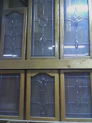 Click for leaded glass page. Leaded glass does not mean the glass is full of lead, rather that lead is used to hold the glass in place. Stained glass is a form of leaded glass for example.