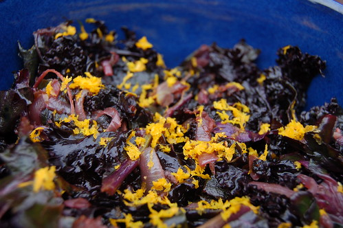 Wilted kale salad with balsamic vinegar, caramelized onions and orange zest
