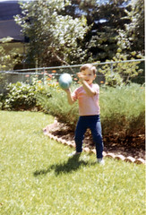Tommy throwing his football (epicharmus) Tags: family flowers trees boy playing ny newyork 1969 fence garden football kid toddler child play suburban lawn suburbia longisland relatives frontlawn neighbor youngster bushes shrubs throw throwing nassaucounty bellmore daddino northbellmore thomasdaddino thebellmores