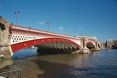 Blackfriars Bridge, London (Thad Roan - Bridgepix) Tags: uk bridge blue red england sky white london water thames river iron europe arch bridges arches historic wikipedia 23 200409 span blackfriarsbridge bridging bridgepixing 01714