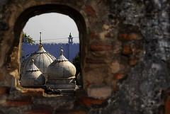Domes of Moti Masjid at Mehrauli seen from a wall in Zafar Mahal. (sanjayausta) Tags: new old india brick history broken window wall architecture construction ancient asia delhi muslim ruin mosque historical monuments domes masjid sanjay marbel shah antiquity zafar mughal mehrauli myeverydaylife austa monumnets bhadhur